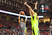 LUBBOCK, TX - DECEMBER 29: Davide Moretti #25 of the Texas Tech Red Raiders goes to the basket against Jake Lindsey #3 of the Baylor Bears during the game on December 29, 2017 at United Supermarket Arena in Lubbock, Texas. Texas Tech defeated Baylor 77-53. (Photo by John Weast/Getty Images) *** Local Caption *** Davide Moretti;Jake Lindsey