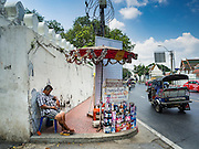 07 APRIL 2016 - BANGKOK, THAILAND: A fireworks vendor has his stand set up in front of the eviction notice near the entrance to Mahakan Fort. The community is known for fireworks, fighting cocks and bird cages. Mahakan Fort was built in 1783 during the reign of Siamese King Rama I. It was one of 14 fortresses designed to protect Bangkok from foreign invaders, and only of two remaining, the others have been torn down. A community developed in the fort when people started building houses and moving into it during the reign of King Rama V (1868-1910). The land was expropriated by Bangkok city government in 1992, but the people living in the fort refused to move. In 2004 courts ruled against the residents and said the city could take the land. The final eviction notices were posted last week and the residents given until April 30 to move out. After that their homes, some of which are nearly 200 years old, will be destroyed.       PHOTO BY JACK KURTZ