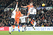 Millwall defender Shaun Hutchinson heads towards goal during the EFL Sky Bet Championship match between Derby County and Millwall at the Pride Park, Derby, England on 20 February 2019.