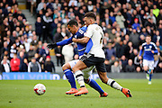 Cardiff City striker, Idriss Saadi (39) and Fulham defender Ryan Fredericks (07) battling for ball during the Sky Bet Championship match between Fulham and Cardiff City at Craven Cottage, London, England on 9 April 2016. Photo by Matthew Redman.