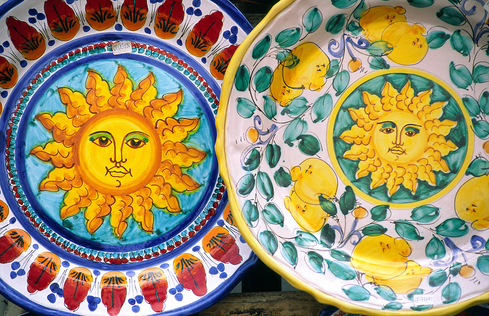 Sicily, Italy. Typical Sicilian sun motifs on locally made ceramic fruit salad plates dishes