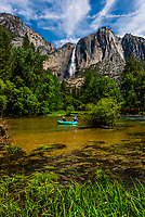 Rafting on the Merced River (with Upper Yosemite Fall behind), Yosemite National Park, California USA.