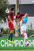 Slovenia defender Gasper Cerne (5) and Portugal midfielder Marco Cruz (10) and defender Gabriel Costa (4) all go up for a header during a CONCACAF boys under-15 championship soccer game, Sunday, August 11, 2019, in Bradenton, Fla. Portugal defeated Slovenia in the final in 2-0. (Kim Hukari/Image of Sport)