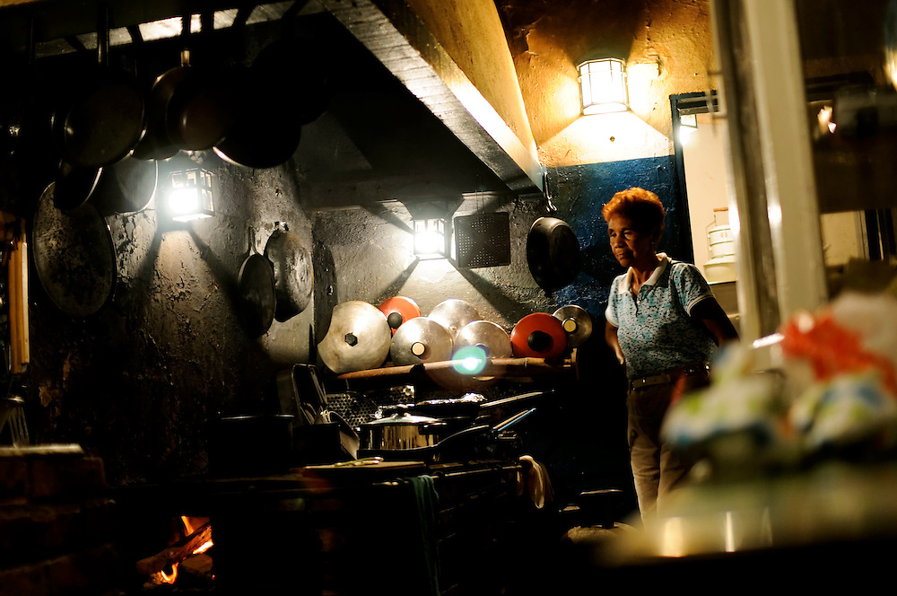 Alejandrina Guzman, 67, prepares a meal on the wood-burning stove in the La Sabanatica hacienda's kitchen on March 27, 2009 in Choroni, Venezuela. La Sabanatica is part of the Monterosa plantation, owned by Kai Rosenberg. Rosenberg is a cacao grower trying to revive the industry in face of challenges such as crop plagues, plantation seizures and government intimidation.