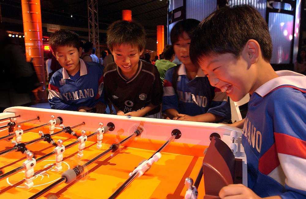 Budding Japanese soccer players compete in a game of table soccer at an indoor soccer event put on for the World Cup at Harajuku, Tokyo. 23/06/02..©David Dare Parker/AsiaWorks Photography