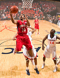 Maryland guard/forward Sean Mosley (14) finishes a layup against UVA.  The Virginia Cavaliers defeated the Maryland Terrapins 68-63 at the John Paul Jones Arena on the Grounds of the University of Virginia in Charlottesville, VA on March 7, 2009.