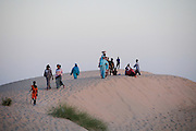 People on the sand dunes outiside of Timbuktu
