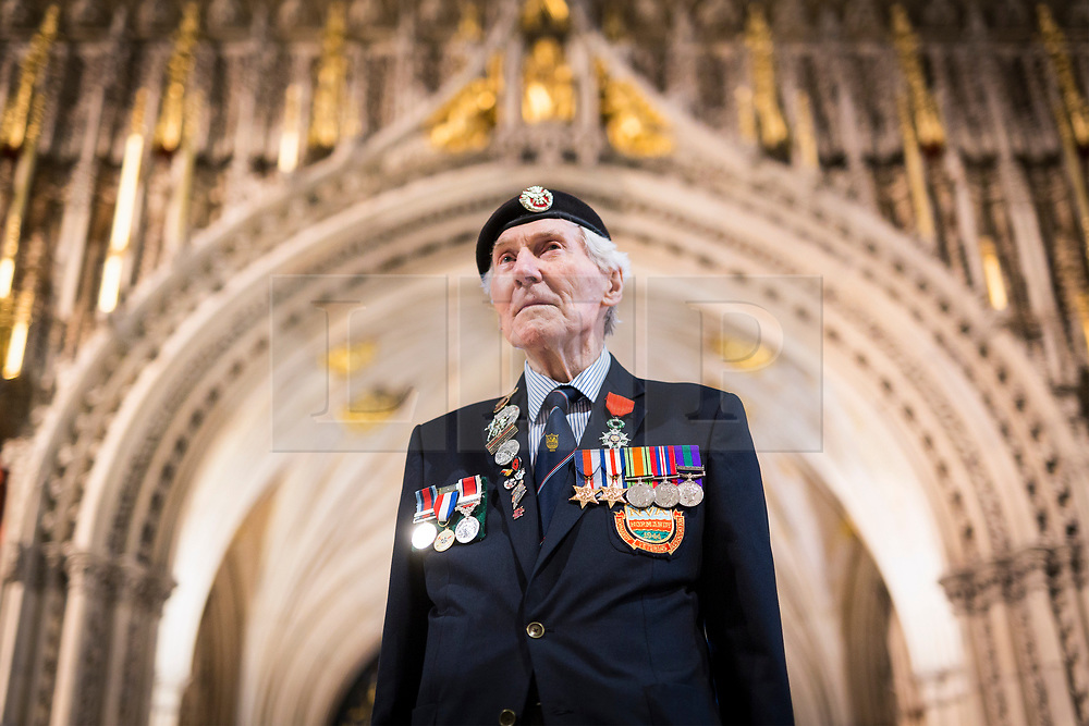 © Licensed to London News Pictures. 14/03/2017. York UK. 92 year old Ken Smith who placed the Normandy Veterans branch standard in it's final resting place at York Minster this morning. The last four members of the York branch of the Normandy Veterans Association have attended a service today at York minster as part of a special memorial to lay-up their standard in it's final resting place in the minster & to all who served in the Normandy campaign in 1944. The standard has been placed in it's case in the North Transept of the minster by Kenneth Smith who was part of the Duke of Cornwall's Light Infantry and landed in Normandy on D-Day June 1944 aged just 19 years old. Mr Smith was joined by the remaining three members of the York branch - Ken Cooke, 91, Albert Barritt, 91 and George Meredith, 92 - and their families for the service. All four veterans were awarded the Legion d'Honneur, France's highest military honour, in May 2016. Photo credit: Andrew McCaren/LNP
