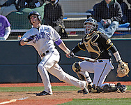 Kansas State catcher Rob Vaughn hits the ball deep to left field in the bottom of the seventh inning against Missouri at Tointon Stadium in  Manhattan, Kansas, April 7, 2007.  Kansas State lost to Missouri 3-0.