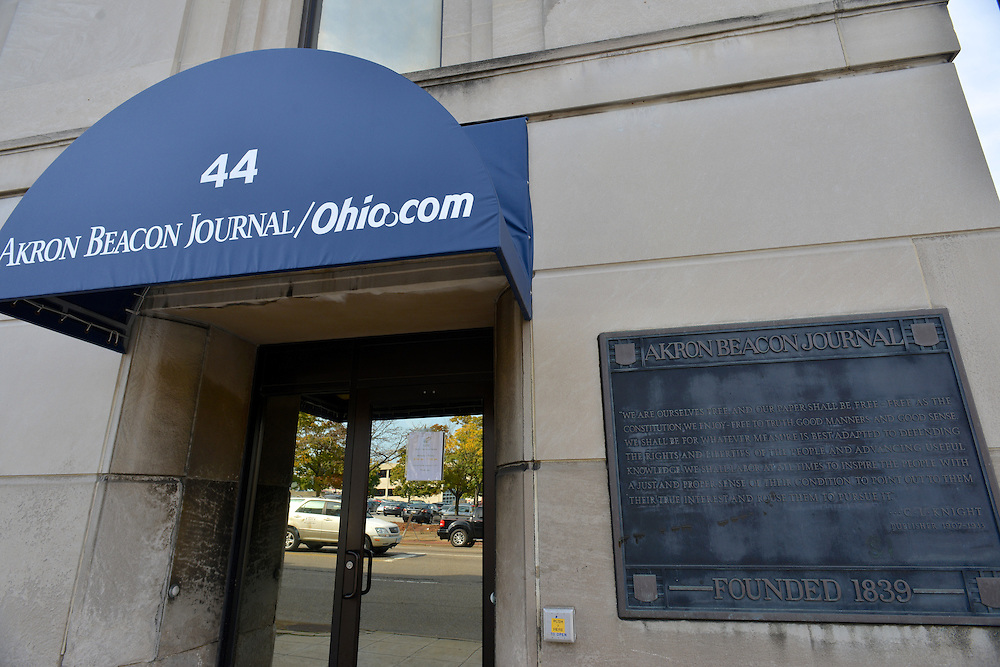 Entrance to the Akron Beacon Journal building, with memorial plaque.