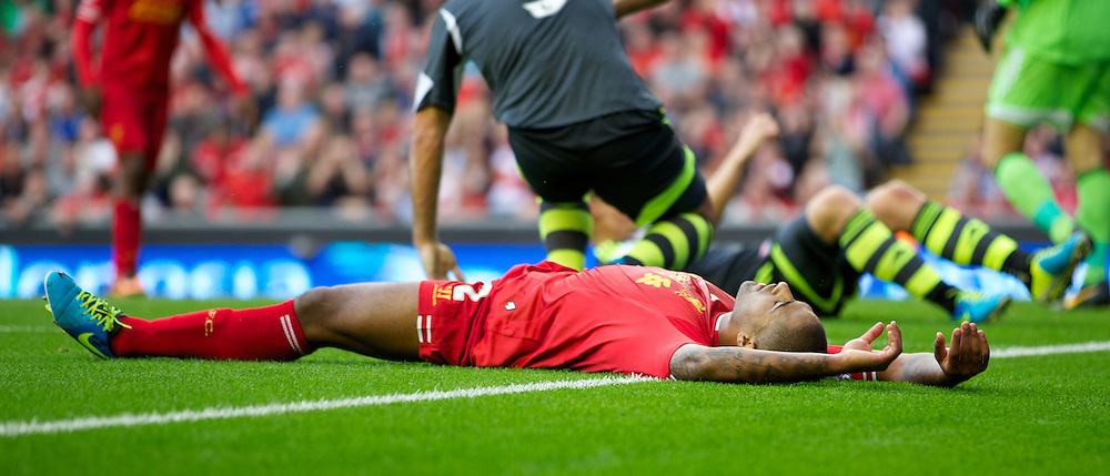 LIVERPOOL, ENGLAND - Saturday, August 17, 2013: Liverpool's Glen Johnson looks dejected after missing a chance against Stoke City during the Premiership match at Anfield. (Pic by David Rawcliffe/Propaganda)
