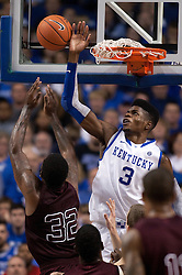 UK forward Nerlens Noel, right, blocks a shot by Texas A&M forward Kourtney Roberson in the second half. The University of Kentucky Men's Basketball team hosted Texas A&M , Saturday, Jan. 12, 2013 at Rupp Arena in Lexington . Photo by Jonathan Palmer/Special to the Courier-Journal.