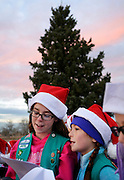 gbs120116d/ASEC -- Elaina Carlson, 10, left, and Savannah Stokesberry, 10, with Girl Scouts' Troop 10308 sing Christmas Carols at the Kirtland Air Force Base tree lighting ceremony on Thursday, Dec. 1, 2016. The annual ceremony features Santa Claus, caroling and refreshments. (Greg Sorber/Albuquerque Journal)