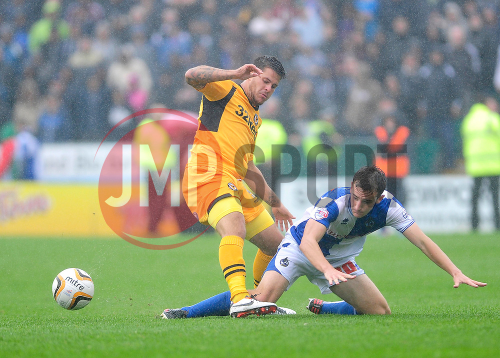 Bristol Rovers' Tom Lockyer is challenged by Newport County's Danny Crow  - Photo mandatory by-line: Dougie Allward/JMP - Tel: Mobile: 07966 386802 17/08/2013 - SPORT - FOOTBALL - Rodney Parade - London - Newport County V Bristol Rovers - Sky Bet league two