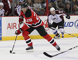 Oct 15; Newark, NJ, USA; New Jersey Devils left wing Patrik Elias (26) skates with the puck during the second period at the Prudential Center.