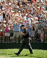 Phil Mickelson of the US reacts to his chip on the 18th green on his way to winning the 2005 PGA Championship at Baltusrol Golf Club in Springfield, New Jersey, Monday 15 August 2005. Mickelson clinched his second major title with a one-shot victory on Monday.