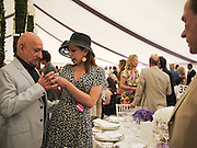 SIR BEN KINGSLEY;DANIELA LAVENDER, Cartier International Polo. Guards Polo Club. Windsor Great Park. 25 July 2010. -DO NOT ARCHIVE-© Copyright Photograph by Dafydd Jones. 248 Clapham Rd. London SW9 0PZ. Tel 0207 820 0771. www.dafjones.com.