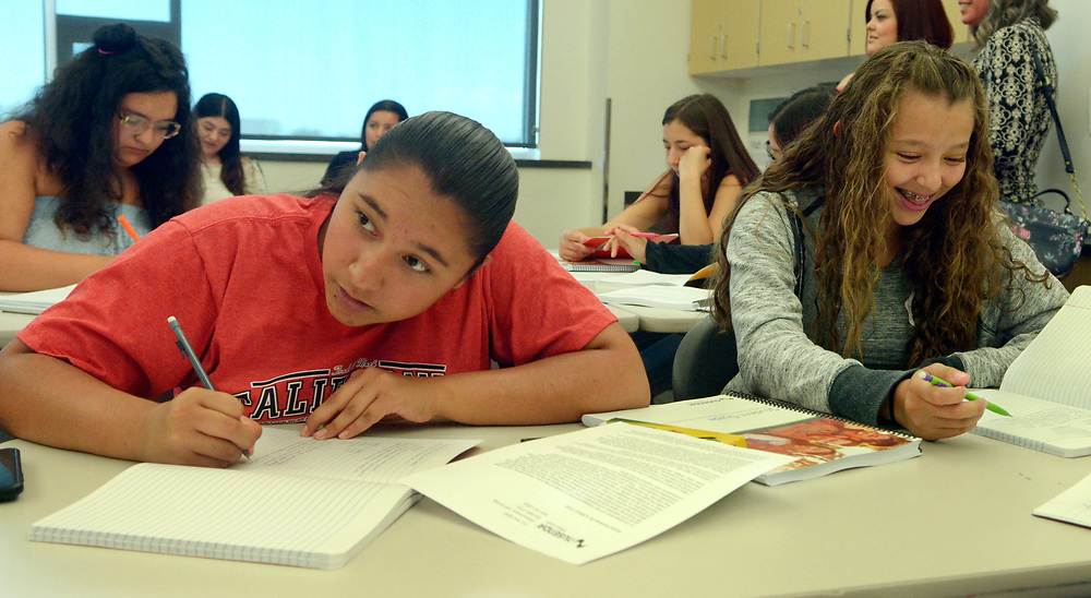gbs060517e/RIO-WEST -- Destenee Alvarez, 15, left, and Catalina Plancarte, 15, take notes during a financial literacy course for high school students at Bernalillo High School on Monday, June 5, 2017. Nusenda Credit Union is offing the free summer course for high school credit. (Greg Sorber/Albuquerque Journal)