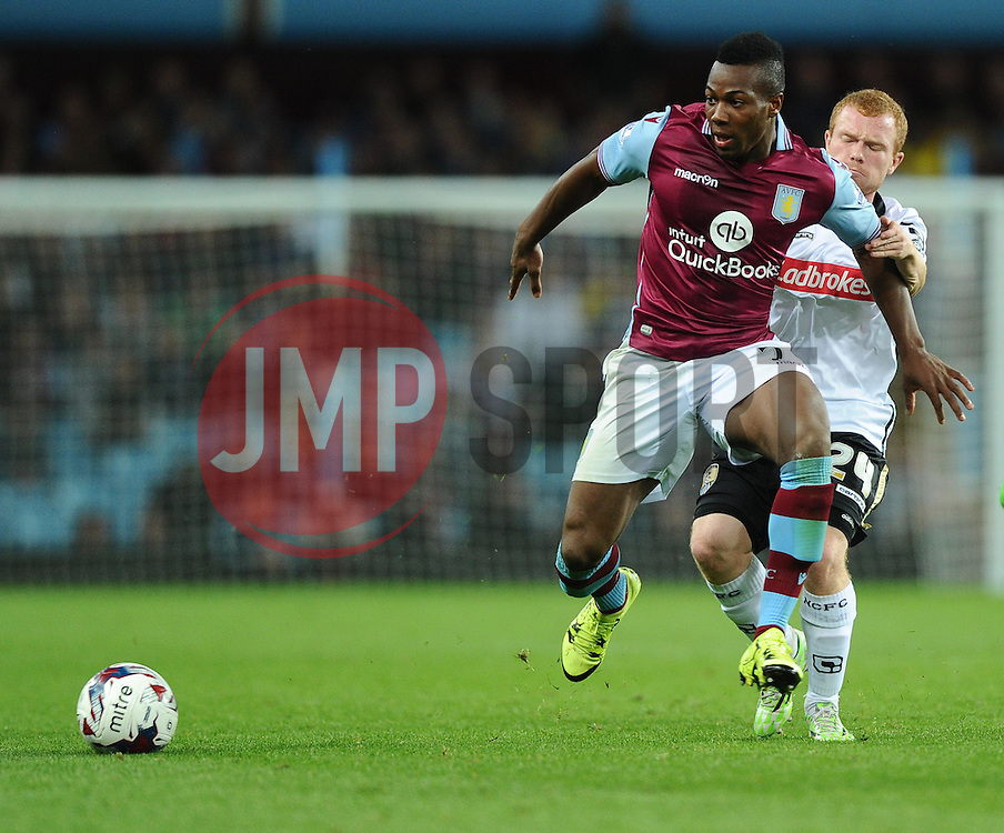 Adama Traore of Aston Villa battles for the ball with Adam Campbell of Notts County  - Mandatory byline: Joe Meredith/JMP - 07966386802 - 25/08/2015 - FOOTBALL - Villa Park -Birmingham,England - Aston Villa v Notts County - Capital One Cup - Second Round