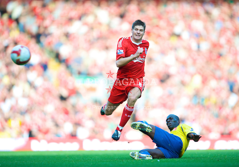 LIVERPOOL, ENGLAND - Saturday, September 20, 2008: Liverpool's captain Steven Gerrard MBE and Stoke City's Mamady Sidibe during the Premiership match at Anfield. (Photo by David Rawcliffe/Propaganda)