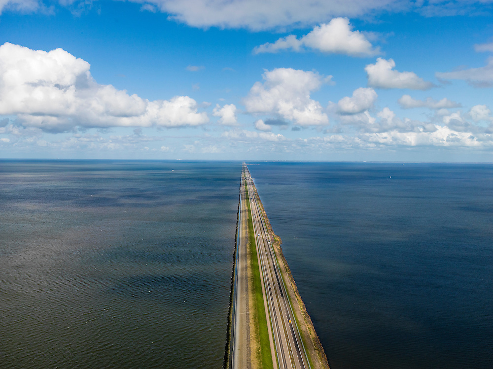 Nederland, Noord-Holland, Gemeente Wieringen, 16-04-2012; Den Oever, begin Afsluitdijk, gezien naar het noordoosten. Aan de horizon is de kust van Friesland zichtbaar. De 32 kilometer lange dijk vormt de waterkering tussen Waddenzee (links) en IJsselmeer (rechts). .Den Oever, beginning Enclosure Dam, looking east. Construction of the dam was part of the Zuiderzee Works, an initiative of engineer Cornelis Lely..luchtfoto (toeslag), aerial photo (additional fee required)..foto/photo Siebe Swart