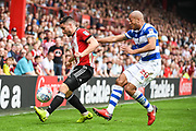 Brentford Forward Neal Maupay (9) and Queens Park Rangers Defender Alex Baptiste (20) battle for the ball during the EFL Sky Bet Championship match between Brentford and Queens Park Rangers at Griffin Park, London, England on 21 April 2018. Picture by Stephen Wright.