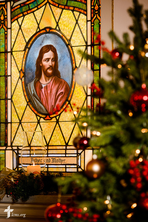 Stained glass depicting Jesus Christ and a Christmas tree in the foreground at Holy Cross Lutheran Church, Collinsville, Ill., on Monday, Nov. 27, 2017. LCMS Communications/Erik M. Lunsford