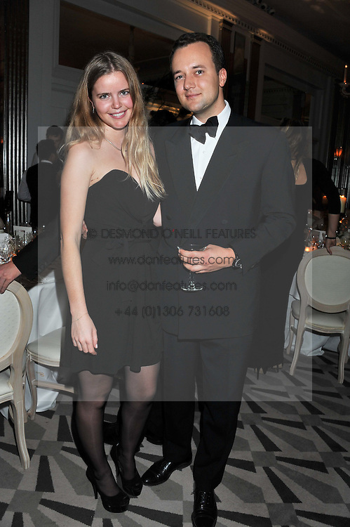 KATIE READMAN and the MARQUESS OF BRISTOL at a dinner and dance hosted by Leon Max for the charity Too Many Women in support of Breakthrough Breast Cancer held at Claridges, Brook Street, London on 1st December 2011.