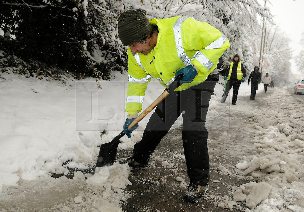 © under license to London News Pictures. 1.12.2010 Snow chaos in Orpington in Kent.  Council dustmen out clearing the ice because the road are to bad to collect rubbish. Station Road, Orpington.. Picture credit should read Grant Falvey/London News Pictures
