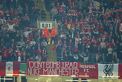 CARDIFF, WALES - Sunday, March 2, 2003: Liverpool fans with banner reading 'Don't Bomb Iraq, Nuke Manchester' during the Football League Cup Final against Manchester United at the Millennium Stadium. (Pic by David Rawcliffe/Propaganda)