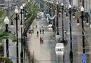 A view of Canal Street that is flooded with water in New Orleans August 30, 2005. The historic city of New Orleans was steadily filling with water from nearby Lake Ponchartrain on Tuesday after its defenses were breached by the ferocity of hurricane Katrina. With the floodwaters rising in many areas, threatening the French Quarter, residents were plucked from the roofs of their homes, bodies were seen floating in the streets and rescuers searched the city in boats and helicopters.