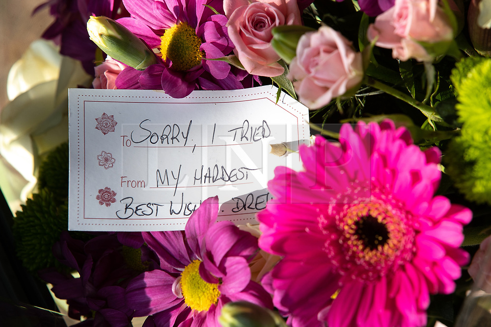 """© Licensed to London News Pictures. 28/05/2018. Stockport, UK. Flowers and tribute reading """" Sorry I tried my hardest """" at the scene outside The Salisbury Club on Truro Avenue in the Brinnington area of Stockport, Greater Manchester, where a car collided with pedestrians late last night, killing one man and injuring others.  A murder investigation has been launched. Police later recovered a black Audi A4 which fled the scene. Photo credit: Joel Goodman/LNP"""