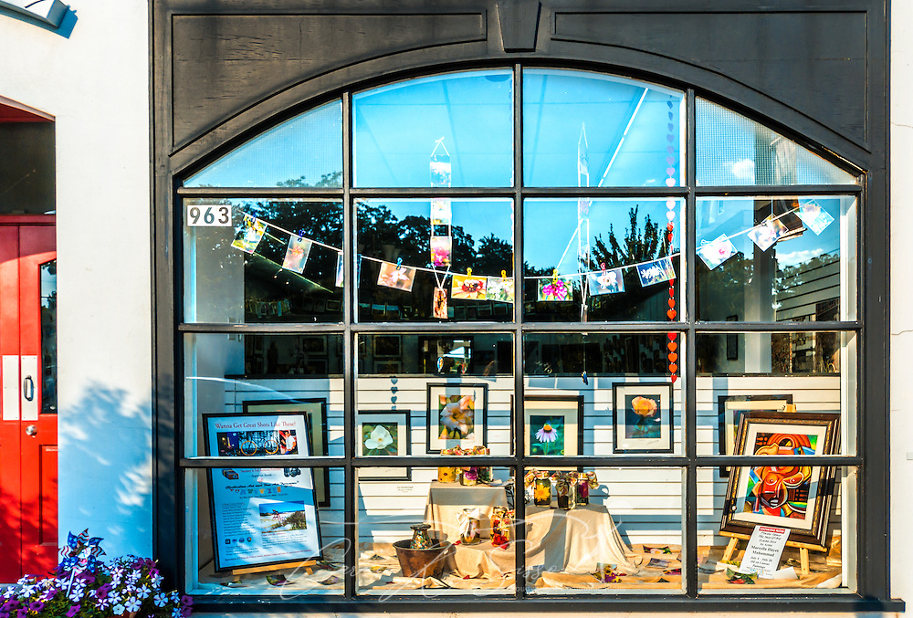 Pictures hang in the window of The Clothesline Art Gallery in Stone Mountain Village, July 5, 2014, in Stone Mountain, Georgia. (Photo by Carmen K. Sisson/Cloudybright)