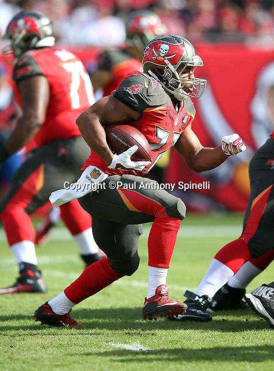 Tampa Bay Buccaneers running back Doug Martin (22) runs for a 6 yard gain during the 2015 week 14 regular season NFL football game against the New Orleans Saints on Sunday, Dec. 13, 2015 in Tampa, Fla. The Saints won the game 24-17. (©Paul Anthony Spinelli)