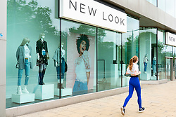 Edinburgh, Scotland, UK. 17 June, 2020. Views from Edinburgh city centre before expected relaxation of covid-19 lockdown by Scottish Government. Pictured; Jogger runs past closed branch of New Look store. Iain Masterton/Alamy Live News