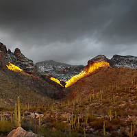 Sunlight breaking through the clouds to create this incredible light on Finger Rock in the Catalina Mountains.  Tucson AZ