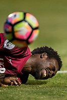 Sacramento Republic FC forward Trevin Caesar (19), goes down on the turf after he was hit by the Real Monarchs SLC goal keeper as the Sac Republic host the Real Monarchs SLC at Papa Murphy's Park, Wednesday Sep 27, 2017. The Monarchs won the match 2-0.<br /> photo by Brian Baer