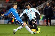 Shrewsbury Town FC midfielder Junior Brown in a hard challenge with Peterborough United midfielder Harry Beautyman during the Sky Bet League 1 match between Peterborough United and Shrewsbury Town at the ABAX Stadium, Peterborough, England on 12 December 2015. Photo by Aaron Lupton.