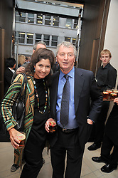 STEPHEN QUINN and his wife KIMBERLEY at a reception hosted by Vogue and Burberry to celebrate the launch of Fashions Night Out - held at Burberry, 21-23 Bond Street, London on 10th September 2009.