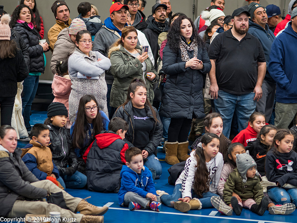 11 DECEMBER 2019 - DES MOINES, IOWA: Members of the Our Lady of the Americas Catholic Church parish watch the Virgin of Guadalupe celebration at Our Lady of the Americas Catholic Church in Des Moines. Virgin of Guadalupe Day is one of the most important holy days in Mexican Catholicism. It marks Dec. 12, 1531, the day Juan Diego, an indigenous Mexican peasant, saw an apparition of the Virgin Mary on a barren hillside in what is now Mexico City. A basilica was built on the site. Virgin of Guadalupe Day is celebrated throughout Mexico and in Mexican communities in the United States.               PHOTO BY JACK KURTZ