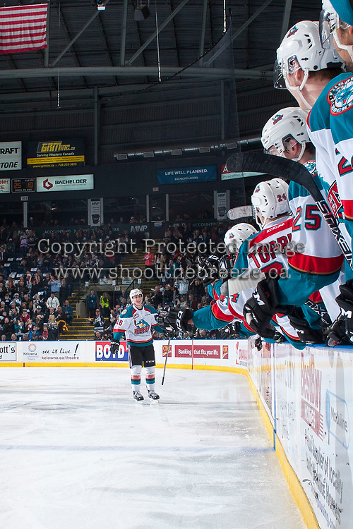 KELOWNA, CANADA - APRIL 7: Kole Lind #16 of the Kelowna Rockets skates to the bench to celebrate a goal against the Portland Winterhawks on April 7, 2017 at Prospera Place in Kelowna, British Columbia, Canada.  (Photo by Marissa Baecker/Shoot the Breeze)  *** Local Caption ***