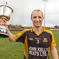 Ballyea's Captain Frankie Griffin holds up the Junior B Hurling trophy after his sides win against Whitegate