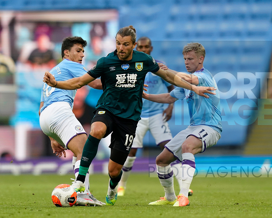 Jay Rodriguez of Burnley between Rodrigo and Oleksandr Zinchenko of Manchester City during the Premier League match at the Etihad Stadium, Manchester. Picture date: 22nd February 2020. Picture credit should read: Andrew Yates/Sportimage