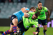 SYDNEY, NSW - MAY 19: Highlanders player Elliot Dixon hit in a big tackle at week 14 of the Super Rugby between The Waratahs and Highlanders at Allianz Stadium in Sydney on May 19, 2018. (Photo by Speed Media/Icon Sportswire)