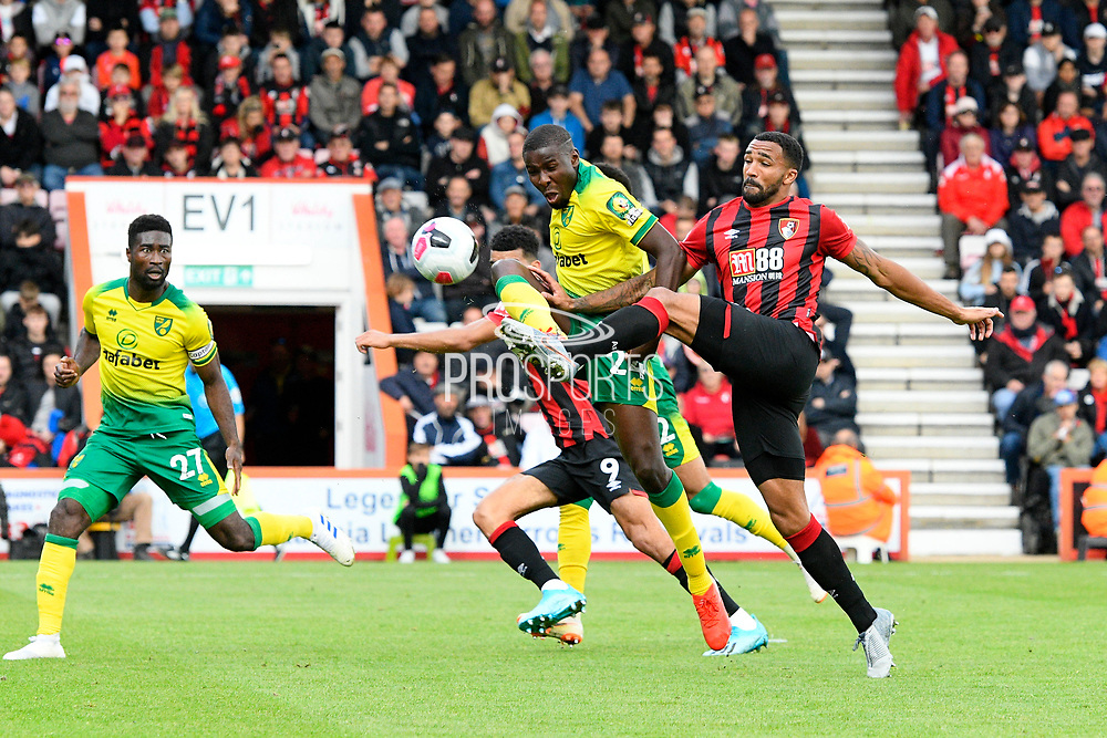 Callum Wilson (13) of AFC Bournemouth shoots at goal as he is challenged by Ibrahim Amadou (24) of Norwich City during the Premier League match between Bournemouth and Norwich City at the Vitality Stadium, Bournemouth, England on 19 October 2019.