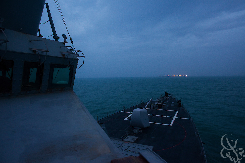 US Navy Destroyer USS Hopper patrols inside a nautical exclusion zone around the Al Basrah Oil terminal (ABOT, seen on the horizon) February 4, 2010 50 kilometers off the coast of Iraq in the Northern Arabian Gulf. ABOT is currently protected by US and UK sailors and Marines from several warships assigned to Combined Joint Task Force Iraq Maritime in a mission that also emphasizes working with Iraqi forces to develop their capability to soon secure the terminal themselves.