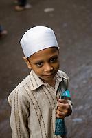 A muslim boy goes to school in Old Delhi, India.