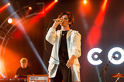 © Licensed to London News Pictures. 14/06/2015. Isle of Wight, UK.   Coasts performing live at Isle of Wight Festival 2015, Day 4 Sunday.   In this picture Chris Caines.Headline acts include The Prodigy, Blur and Fleetwood Mac.   Photo credit : Richard Isaac/LNP