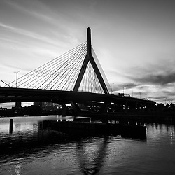 Boston Zakim Bunker Hill Bridge at sunset black and white picture. The Leonard P. Zakim Bunker Hill Memorial Bridge is a cable bridge that spans the Charles River in Boston, Massachusetts in the Eastern United States of America.