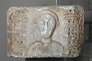Carved stone capital with a human face, cross and foliage decoration, originally from Divjake Lushnje, from the National Museum of Medieval Art, Korce, Albania. Picture by Manuel Cohen